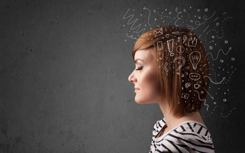 21891861 – young girl thinking with abstract icons on her head
